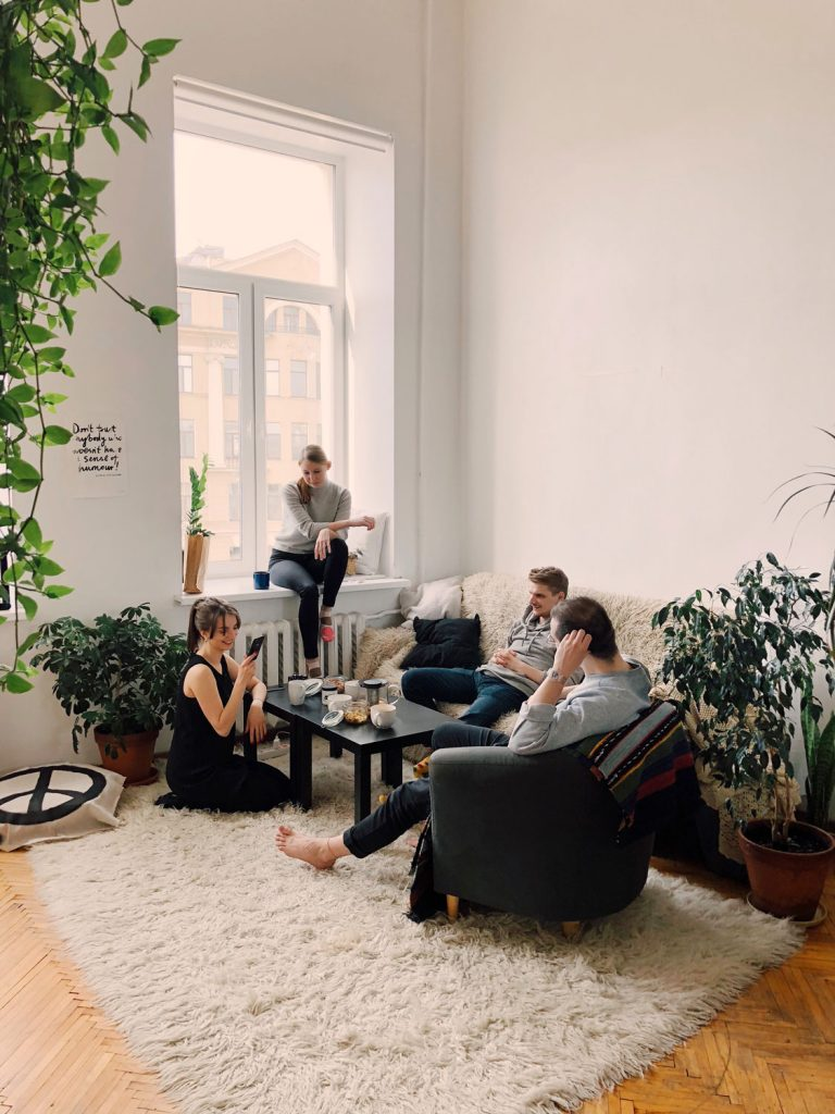 young friends sitting in apartment