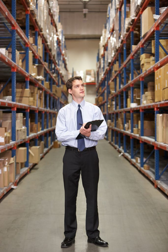 business manager reviewing his warehouse