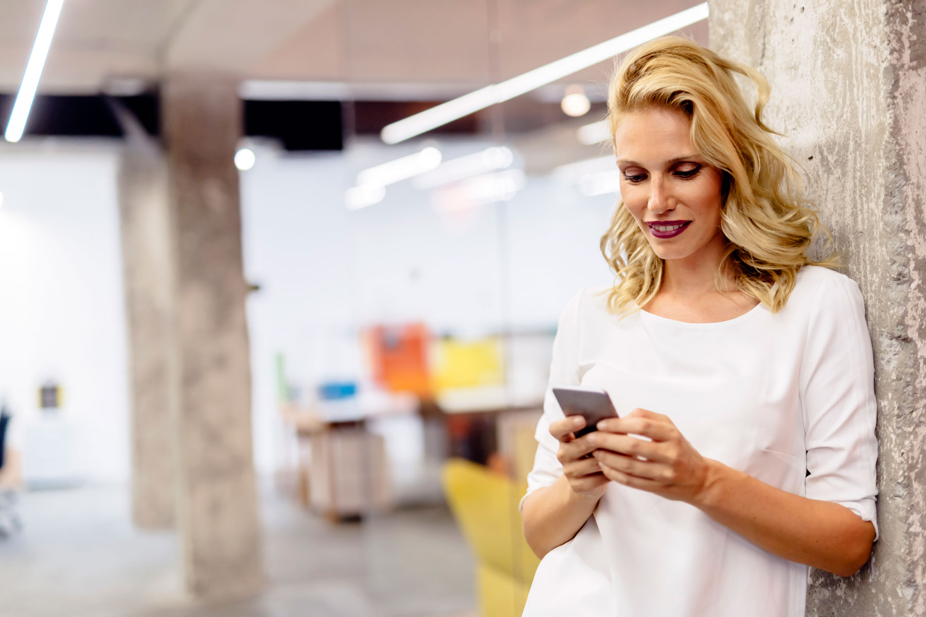woman looking at bank account on phone