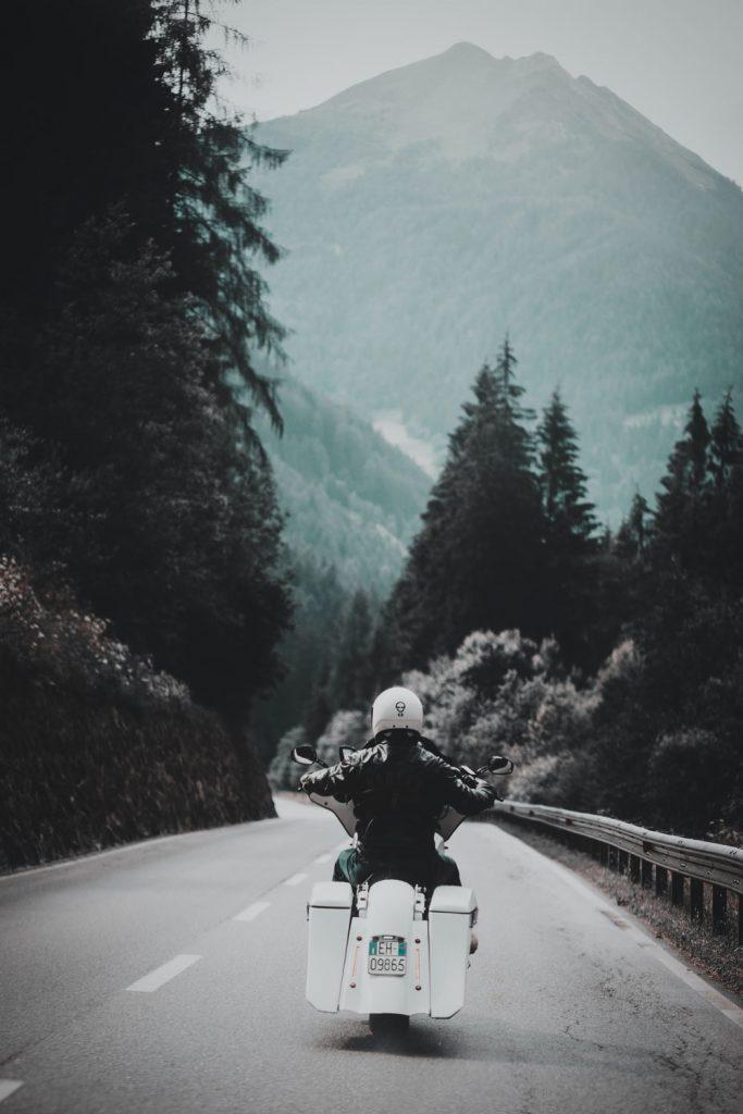 man riding motorcycle in mountains