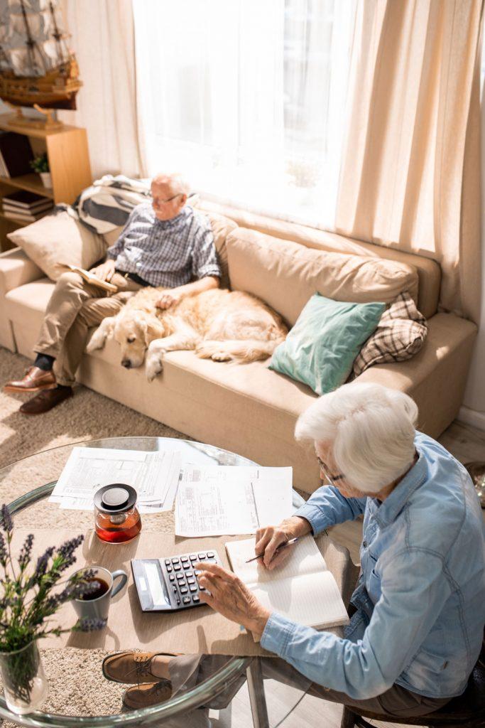 elderly couple paying bills