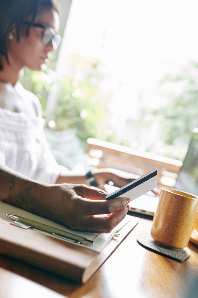 woman using debit card online